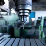 industrial-metal-drill-machine-metalworking-workshop.jpg